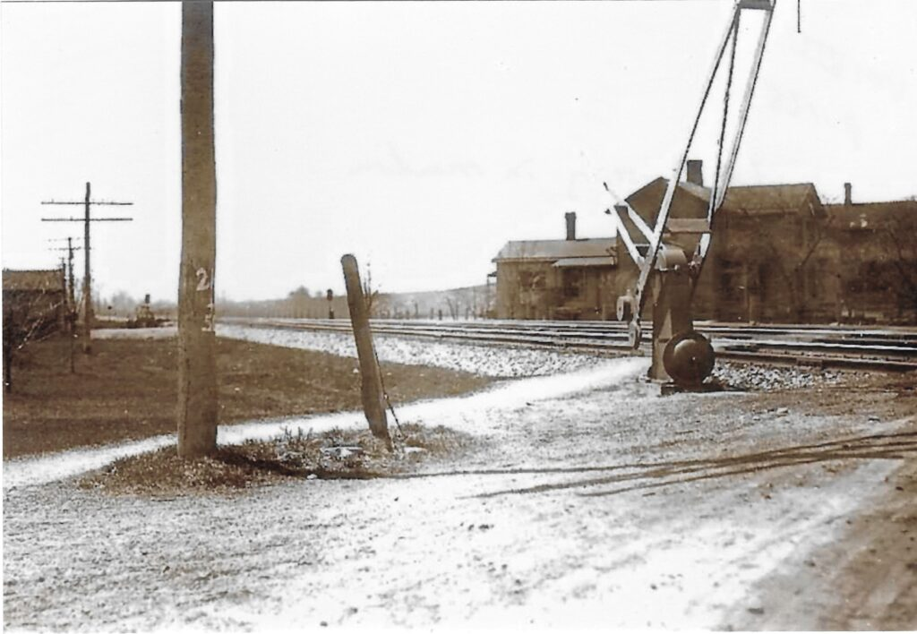 LVRR crossing in Mendon. Route 251 looking west. The left hand side would be where the ballfields are today. Originally from collection of Jackson Smith. Courtesy of Honeoye Falls - Town of Mendon Historical Society Collection.