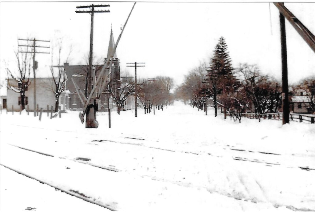 Rush-Mendon Road in Mendon, looking east. Originally from collection of Jackson Smith. Courtesy of Honeoye Falls - Town of Mendon Historical Society Collection.