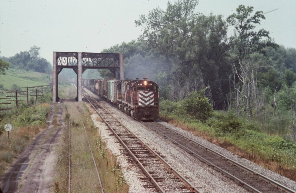 Lehigh Valley Eastbound freight crossing 3 track bridge over Honeoye creek, west of Rochester Junction, 1973. Bridge still stands and is part of the Lehigh Valley trail. Rick Rubino photo