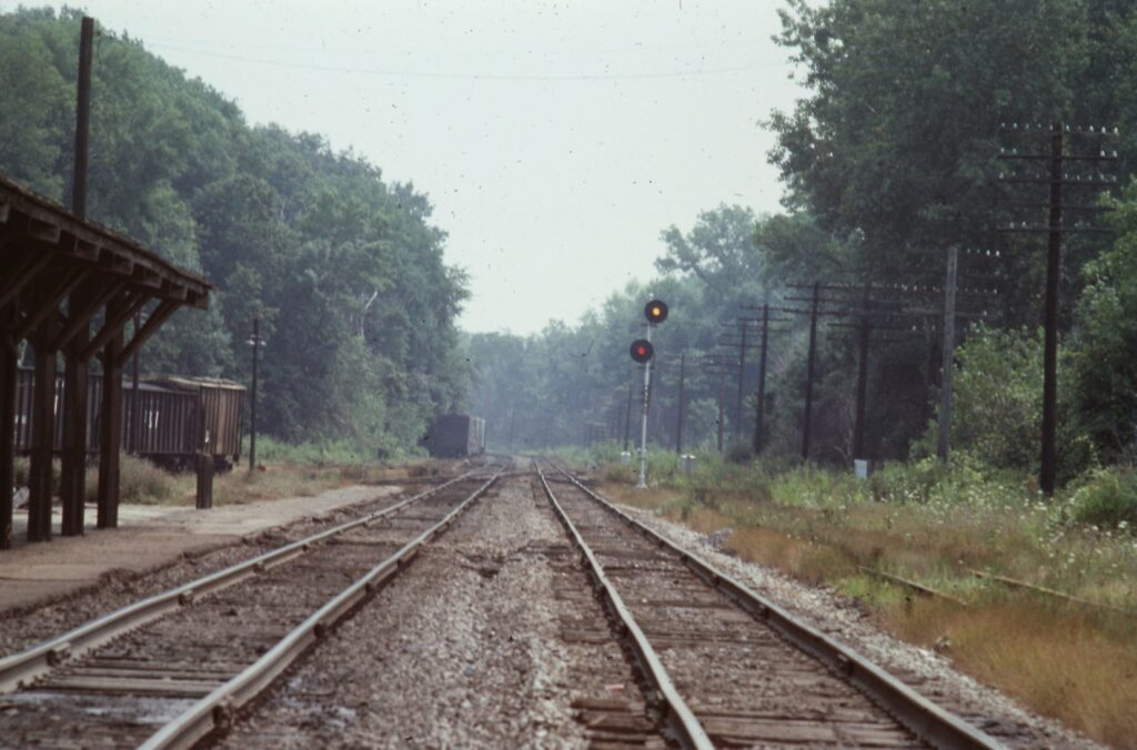 Lehigh Valley railroad looking East at Rochester Junction, 1973. The Clover Street bridge is just around the curves ahead and the Crossover tracks are the Rochester Branch which went from the Yards at Mount Hope ave to Lima. Rick Rubino photo.