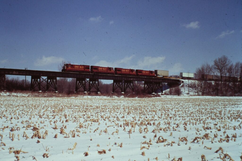 Lehigh Valley U23Bs crossing the trestle to the Genesee River bridge near Rush, winter 1975. The bridge is still in use and is part of the Lehigh Valley trail. This approach span was removed in the early 1980s. Jim Crosby photo.