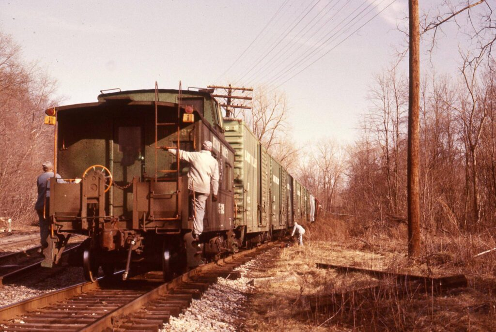Lehigh Valley Rochester Junction, early 1970s. Heading to Honeoye Falls and Lima on the Rochester Branch. The Locomotive has just crossed over a small bridge the Boy Scouts refurbished some years back. Ron Amberger Photo.