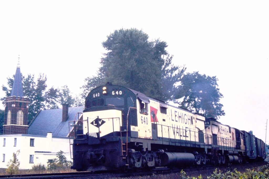 Lehigh Valley RR eastbound train, led by 2 Alco C628 Snowbirds passing through Mendon, NY on September 26, 1972. This is now Mendon Station Park. Paul J. Templeton photo.