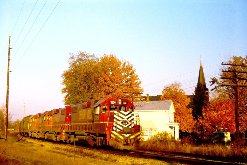Lehigh Valley RR westbound train about to cross NY Rt. 251 in Mendon, NY on October 25, 1973. Paul J. Templeton photo.