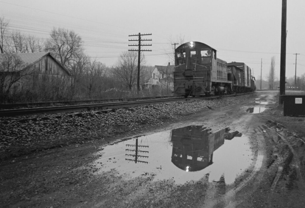 Lehigh Valley Railroad local RM-2 passing through Mendon, NY on March 4, 1974. Train has just crossed Route 251 and is Eastbound. Paul J. Templeton photo.