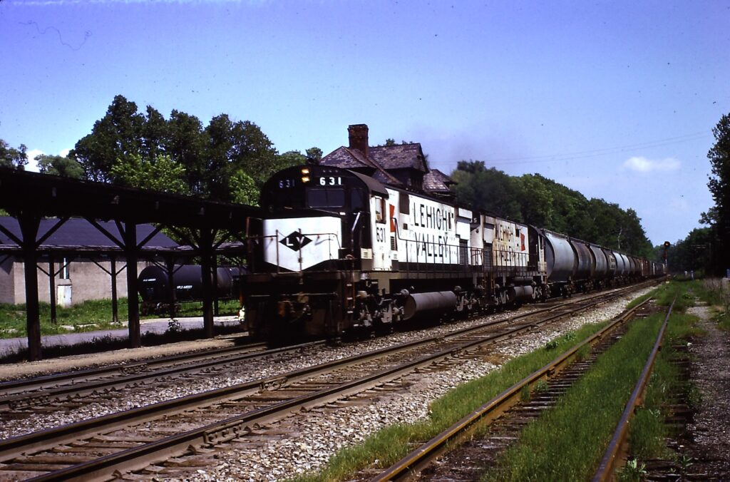 Lehigh Valley Railroad train NE-1 westbound passing the  Rochester Junction station in June of 1972. Station burned to the ground April 22 1973. Richard Pearson photo.