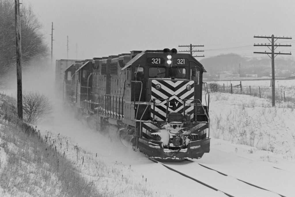 Lehigh Valley RR train AP-2 crossing Old Dutch Road east of Mendon, NY on January 9, 1974. Paul J. Templeton photo.