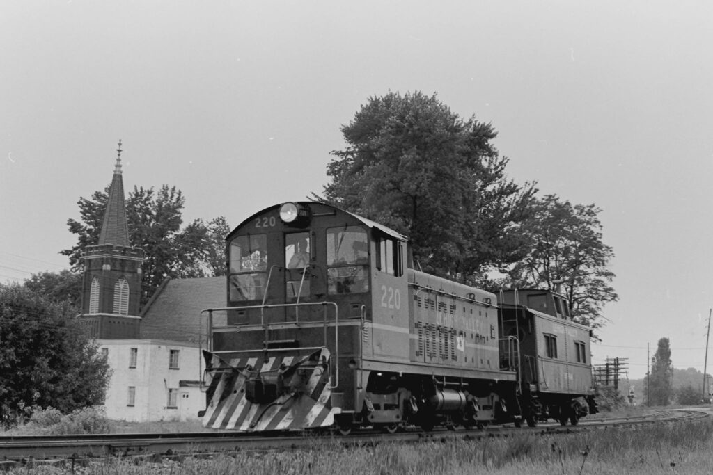 Lehigh Valley Railroad local RM-2 with a caboose hop at Mendon, NY June, 1972. This is now Mendon Station Park and a short stretch of panel tracks sits right about where the locomotive is. Paul J. Templeton photo.