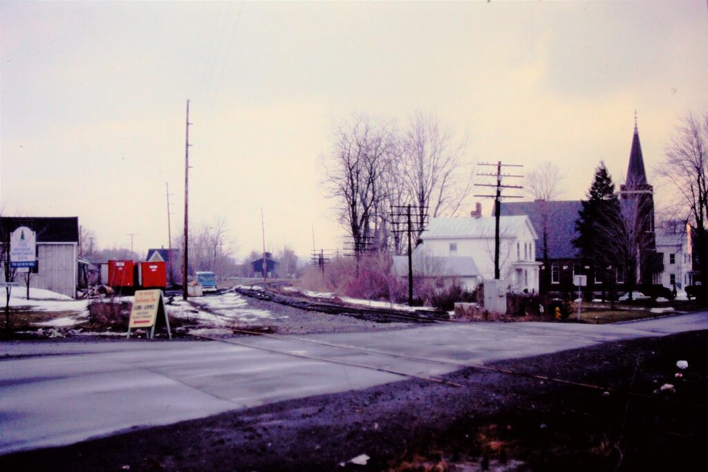 Lehigh Valley Railroad in Mendon, NY March 1978. Tracks have been partially torn up, crossing signals have been removed at this grade crossing, which is route 251. The signals on Route 64 stayed up for a few more years after the tracks were torn up, then they were gone too. View is railroad east and Mendon station park is now where this all was. Paul J. Templeton photo.