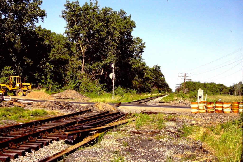 Lehigh Valley Railroad Quaker Meeting House Road July, 1977. Crossing signals removed, tracks being torn up. Approach signals for Rochester Junction still in place. View is railroad east. Paul J. Templeton photo.