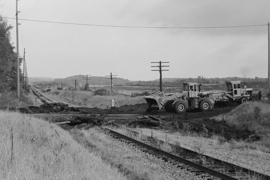Town of Mendon work crew removing the rails and ties on the Lehigh Valley mainline at Old Dutch Road grade crossing in October, 1977. Paul J. Templeton photo.