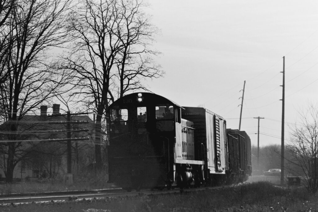 Lehigh Valley Railroad local RM-2 passing through Mendon, NY heading east back to Manchester. February 21, 1974. Train has just crossed Route 251. Paul J. Templeton photo.