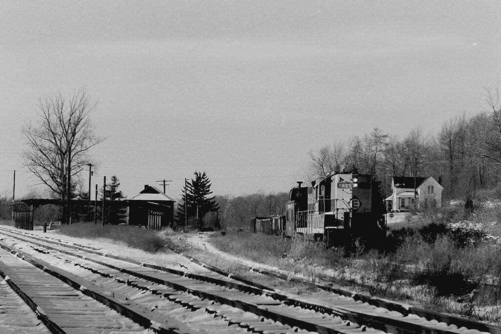 Conrail local EX-1 arriving at ex Lehigh Valley Railroad Rochester Jct. with some gondola cars for A&K Track Materials, which was in the process of pulling up No. 2 track. November 30th, 1976. Paul J. Templeton photo.