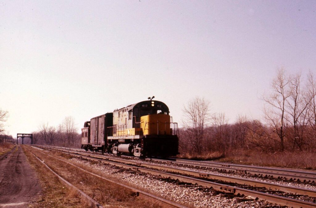 Last eastbound freight heading into Rochester Junction, Late March 1976. Ron Amberger photo.