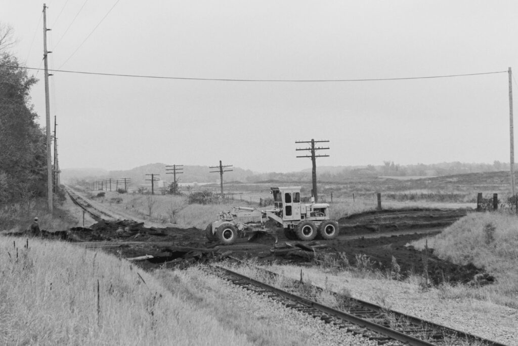 Town of Mendon crew working at what had been the Lehigh Valley Railroad at the Old Dutch Road grade crossing. October, 1977. Paul J. Templeton photo.