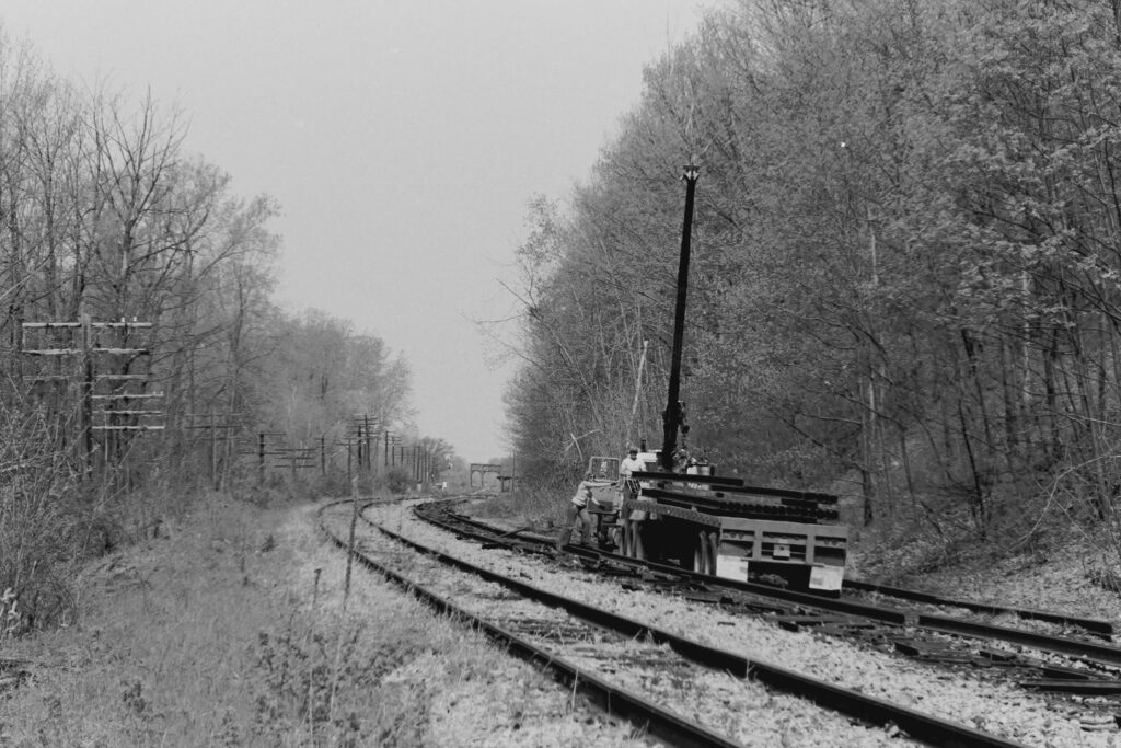Another shot of A&K Track Materials picking up rail just east of Rochester Jct. May 21, 1978. Paul J. Templeton photo.