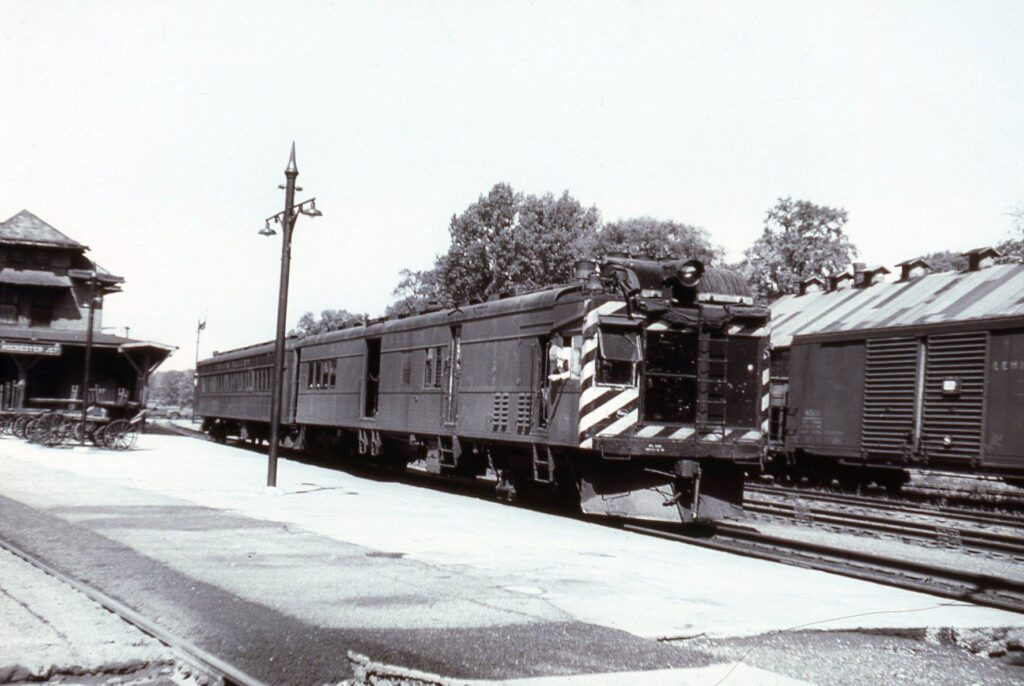 Lehigh Valley gas electric at Rochester Junction. Train had just dropped off mail and passengers from the Rochester station which is now the Dinosaur BBQ. Date unknown. Don Marshall Collection.