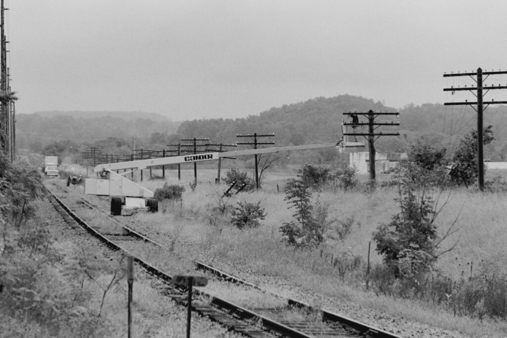 Montel Metals crew removing the C&S wires along Lehigh Valley RR right of way near Old Dutch Road grade crossing east of Mendon, NY on September 23, 1977. Paul J. Templeton photo.