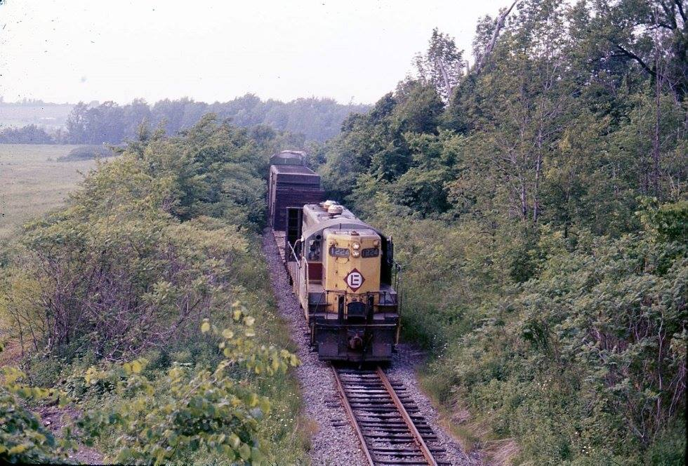 Conrail #1224 (ex-Erie-Lackawanna) with train on the former Lehigh Valley Rochester branch. The train is seen from Erie Station Road overpass in town of Henrietta, NY during summer of 1976. The caboose is former Lehigh Valley. Ron Amberger photo.