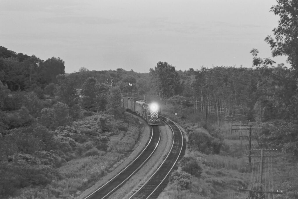 Lehigh Valley Railroad Westbound train BNW-3 with D&H Alco PA units 16 and 19 in the power consist on their way to M-K for rebuild. Taken from the Clover Street overpass on June 24, 1974. Paul J. Templeton photo.