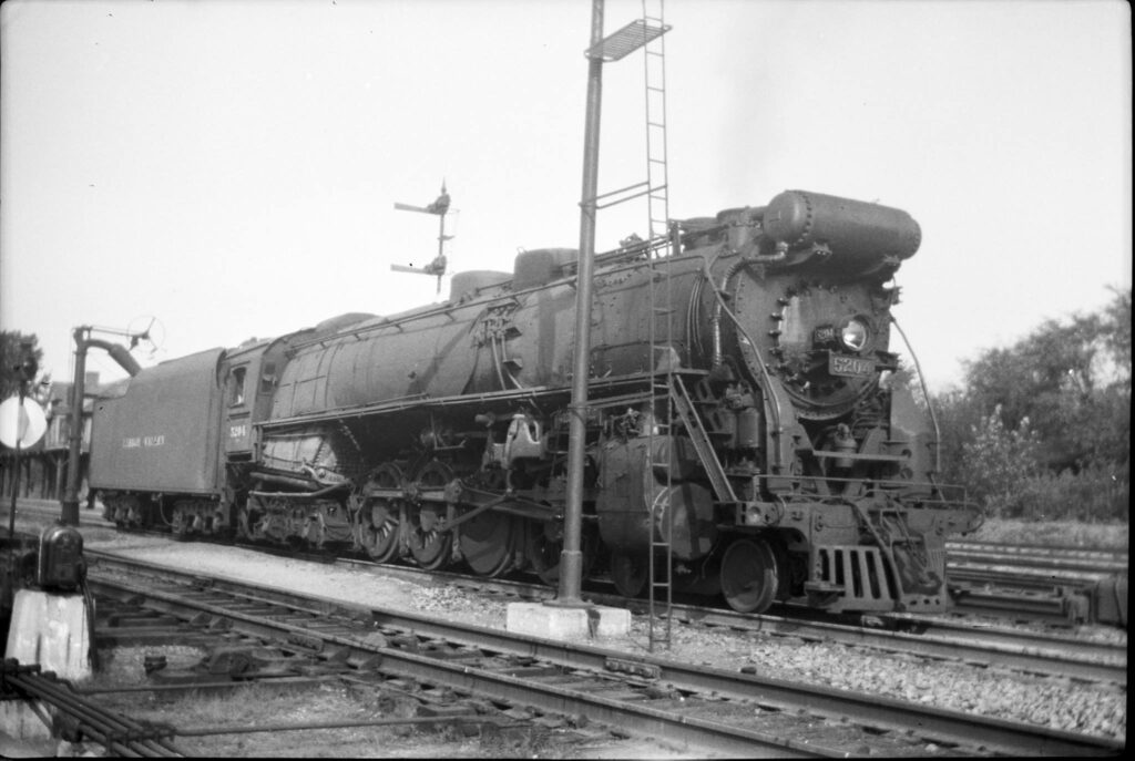 Lehigh Valley Railroad 4-8-4 #5204 takes on water at Rochester Junction, 1950. Station can be seen just behind the tender. J.W. Park Photo. Negative from Peter A Bellisario collection.