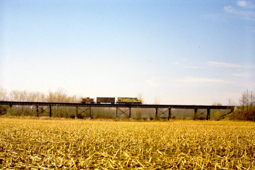 Lehigh Valley Railroad Extra 412 East crossing the Genesee River bridge near Industry, NY. It is believed that the box car was loaded with company material from Tifft Terminal. March 30, 1976. One more day, and it would be over for the Lehigh Valley. Paul J. Templeton photo.