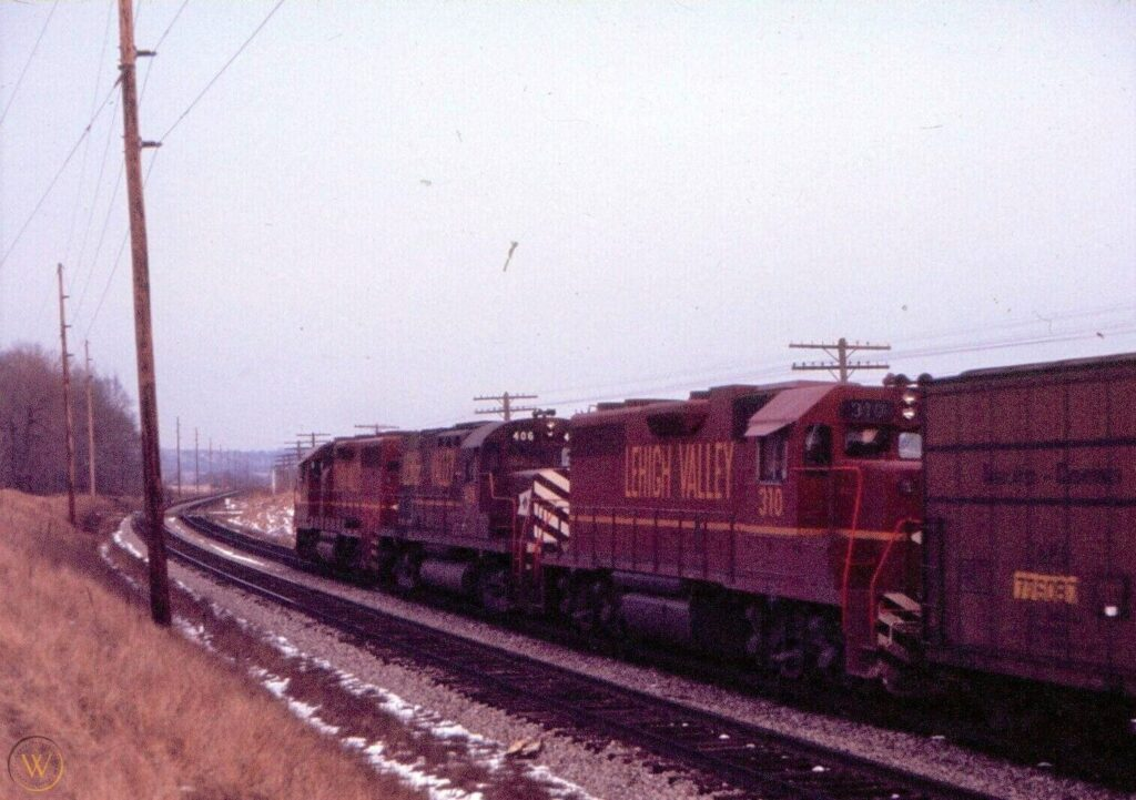 Lehigh Valley 311-406-310 in Victor 2/17/1972. Eastbound; about to cross old Dutch road. Photographer unknown.